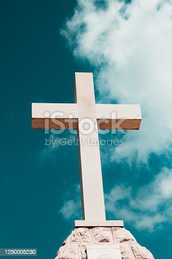 istock Huge white modern cross on the hill near town of Stargrad, island of Hvar in Croatia 1250005230
