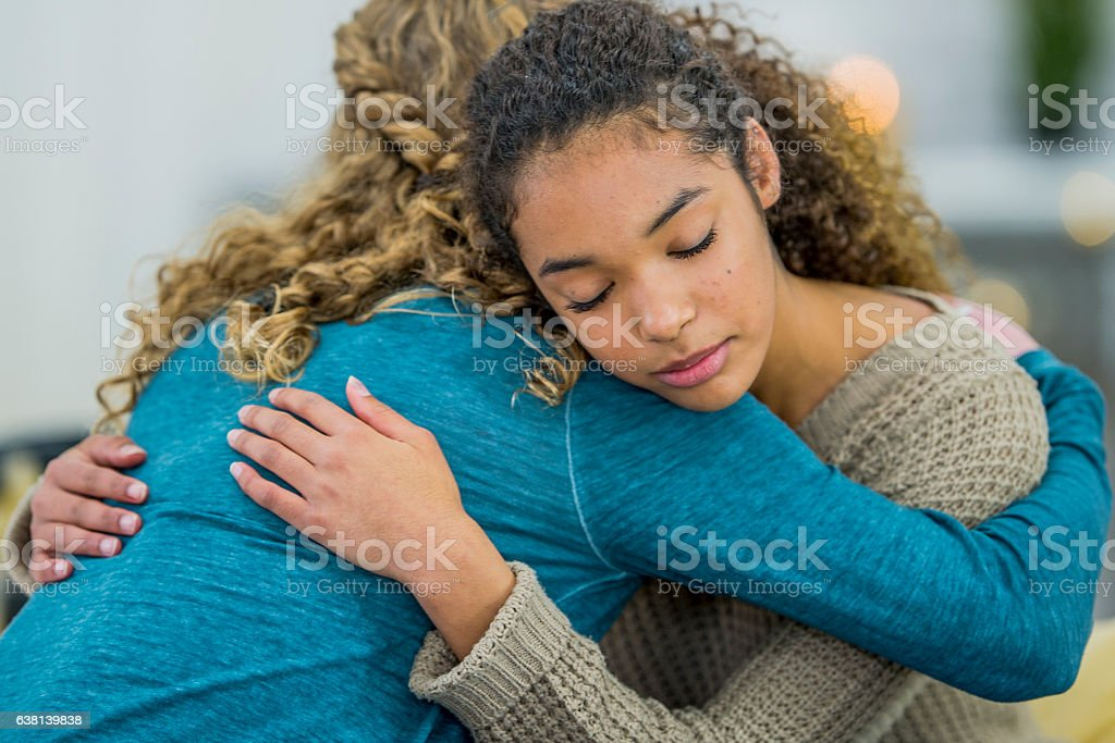 Hugging a Friend stock photo