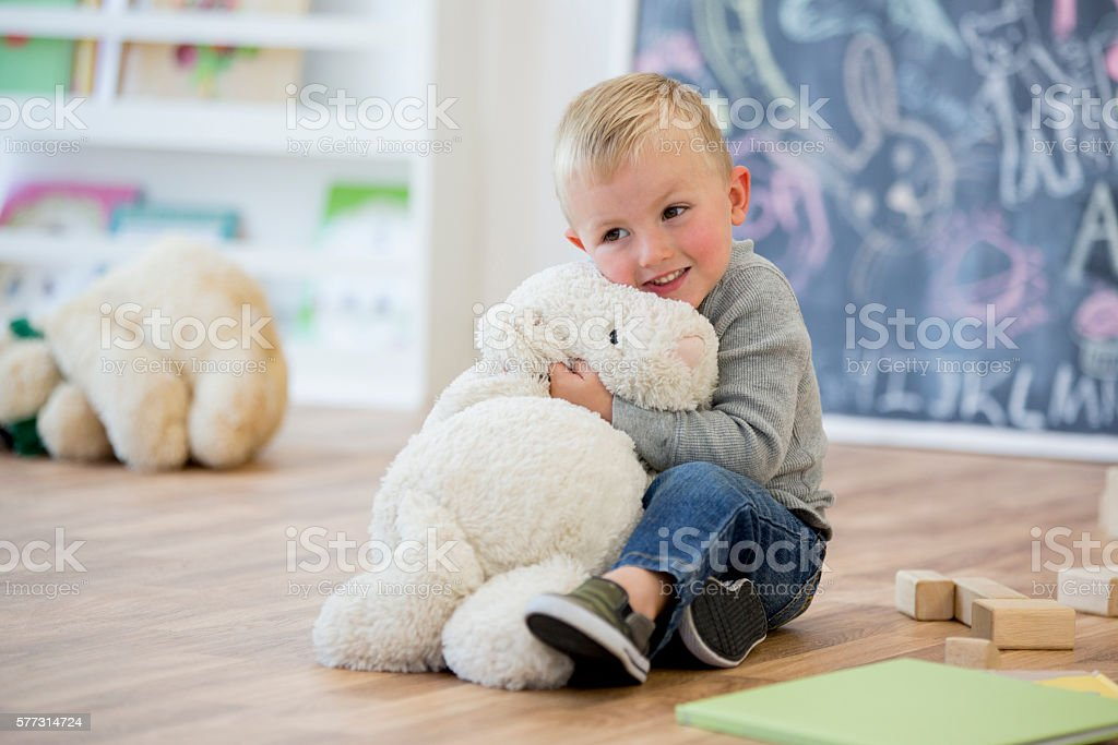Hugging a Stuffed Animal stock photo