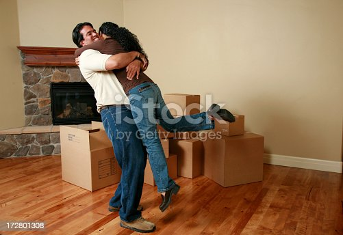 istock Hugging couple cheering for new home 172801308