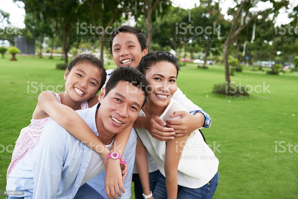 Hugging family stock photo