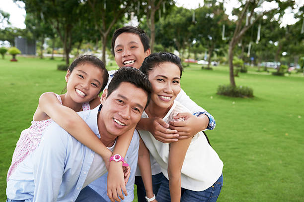 hugging family - east asian ethnicity stock photos and pictures