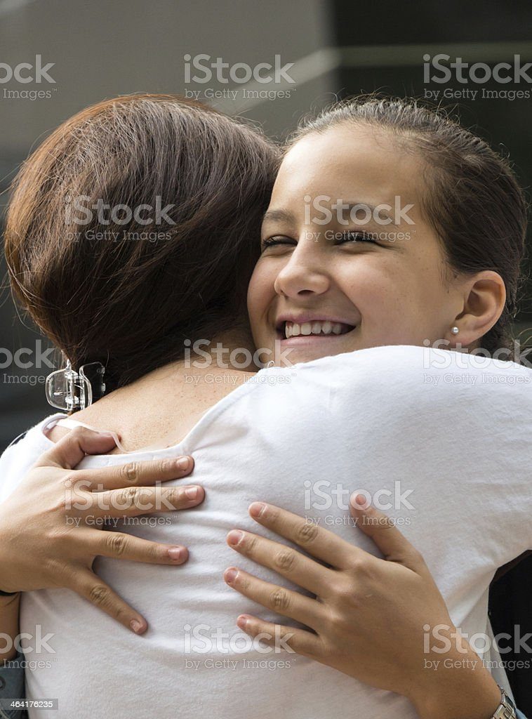 Hugging Goodbye Are Two Female Friends Stock Photo - Download Image