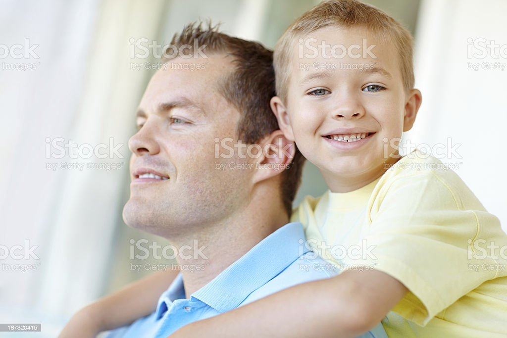 Hugging his dad royalty-free stock photo
