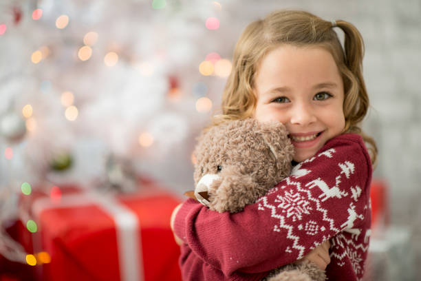 hugging teddy - toy stock pictures, royalty-free photos & images