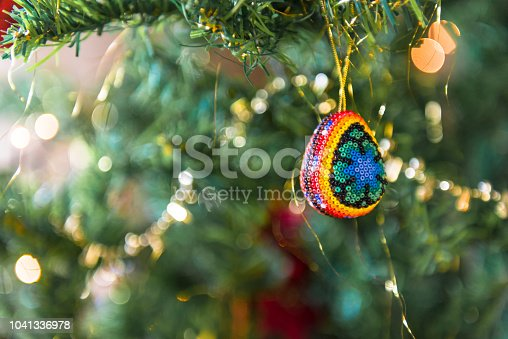 View of a colorful Huichol beaded ornament egg on a Christmas tree