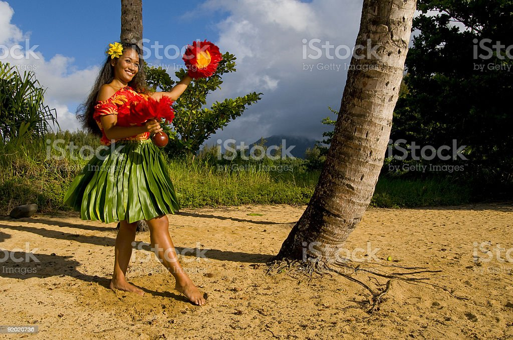 A hula dancer on a beach in Hawaii stock photo