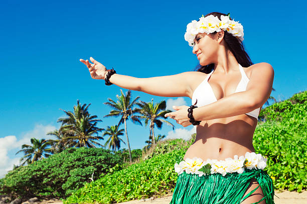 hula dancer on beach - hawaiian ethnicity stock photos and pictures