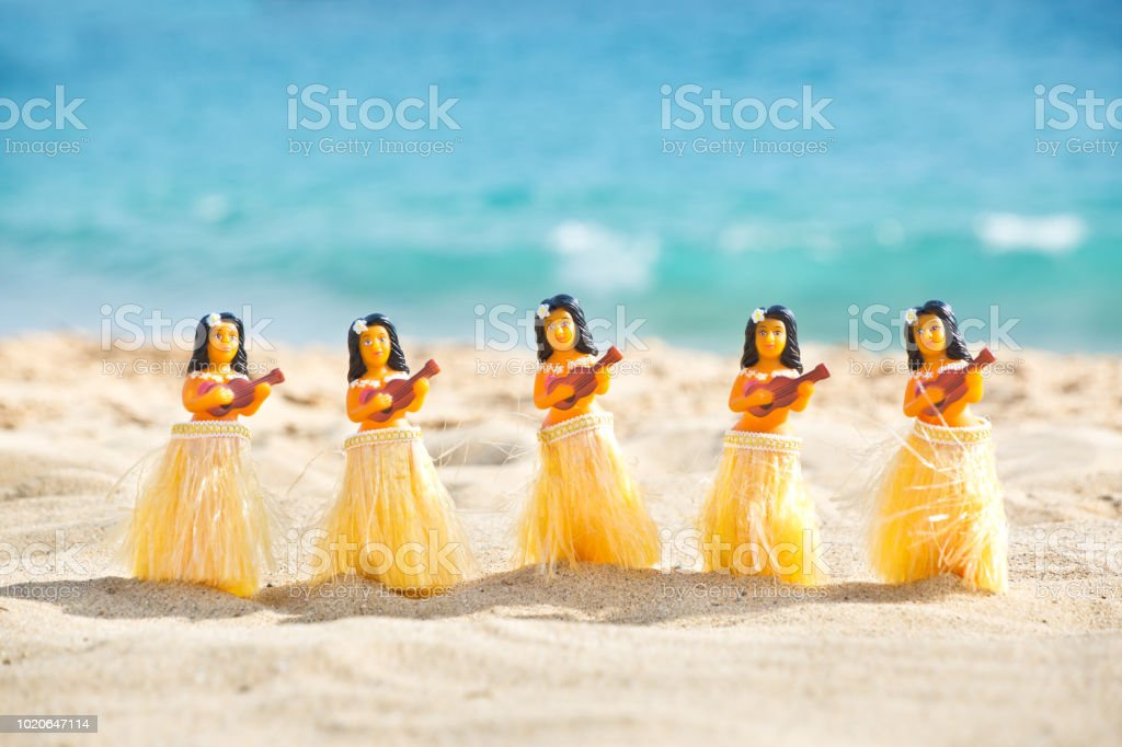Hula Dancers Dolls on the Beach of Lanai Island, Hawaii stock photo