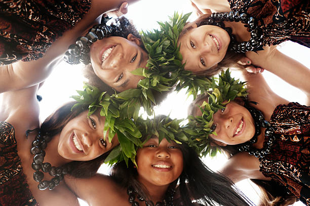hula dancers - hawaiian ethnicity stock photos and pictures