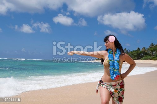 Hula girl dancing on beach