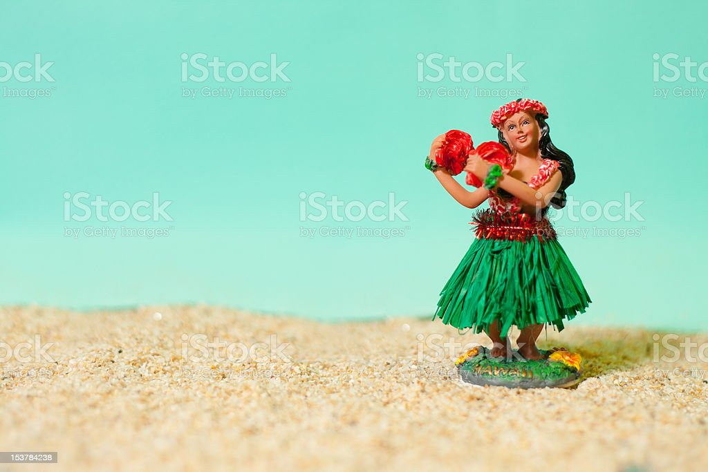 Hula Girl Doll on Sand stock photo