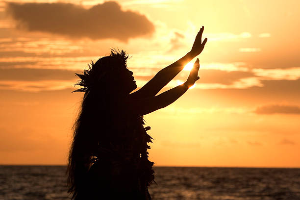 hula girl reaches for the sun - hawaiian ethnicity stock photos and pictures