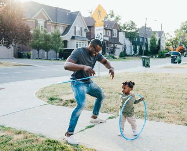 Hula hoop with dad stock photo
