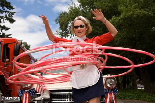 Woman with hula hoops in parade