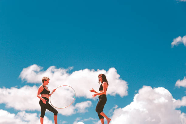 hula hoopers in heaven - katiedobies stock pictures, royalty-free photos & images