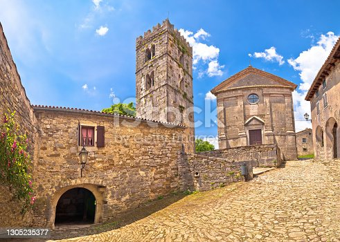 istock Hum. Historic stone square and church in smallest town in the World Hum 1305235377