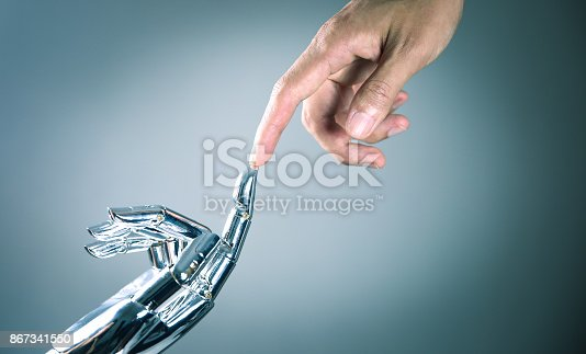 867341648 istock photo Human and robot hand connecting 867341550