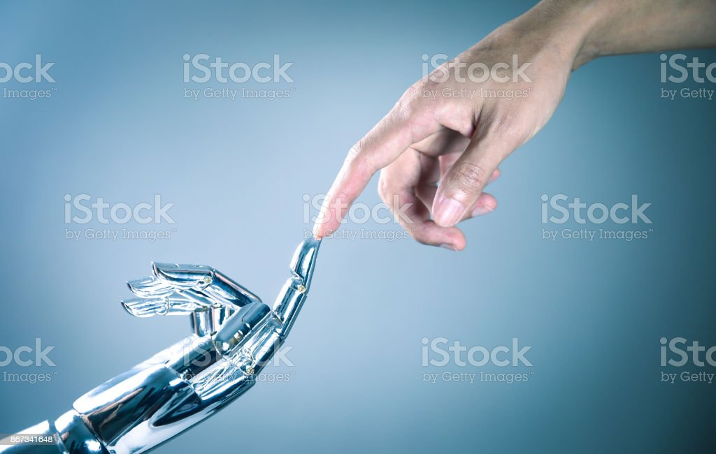 Human and robot hand connecting стоковое фото
