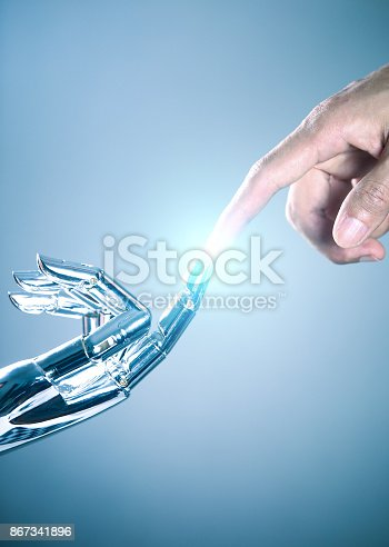 867341648 istock photo Human and robot hand connecting 867341896