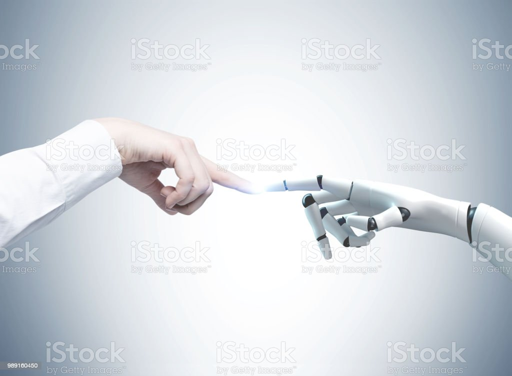 Human and robot hands reaching out, gray stock photo