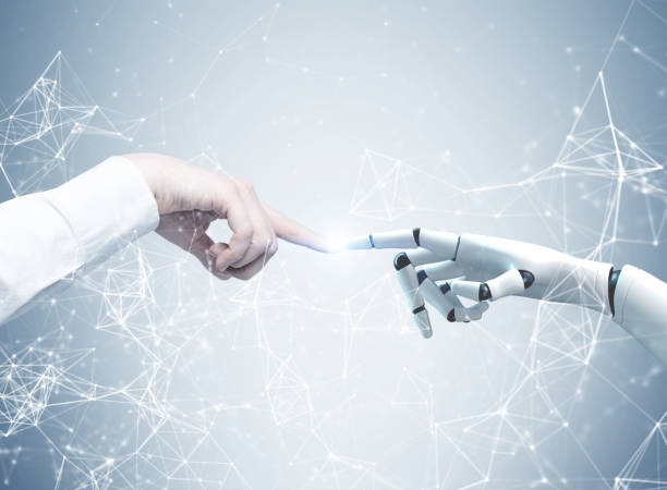 Human and robot hands reaching out, network stock photo