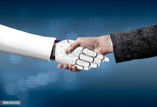 istock Human and robot shaking hands 856484032