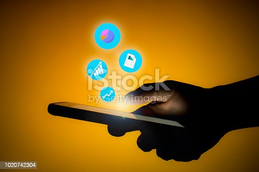 1054574038 istock photo Human are checking stock market graph 1020742304