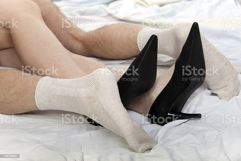 Women wearing shoes sex bed