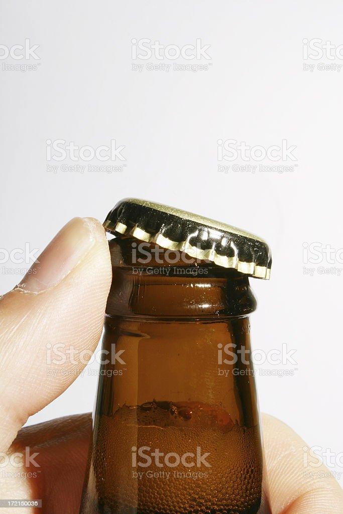 Human beer opener stock photo