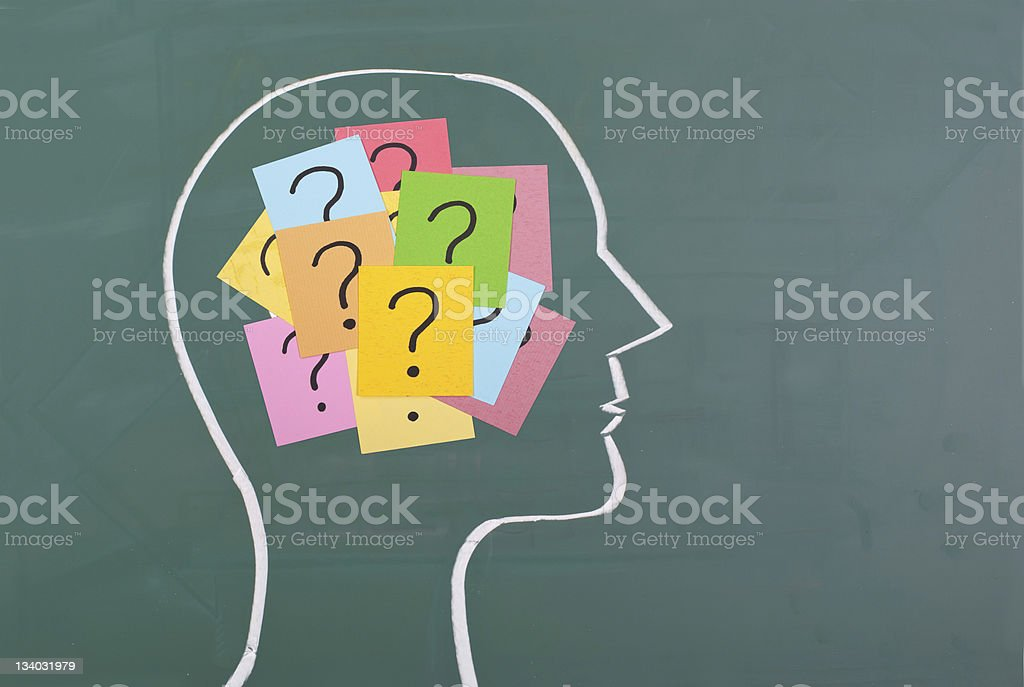 Human brain and colorful question mark stock photo