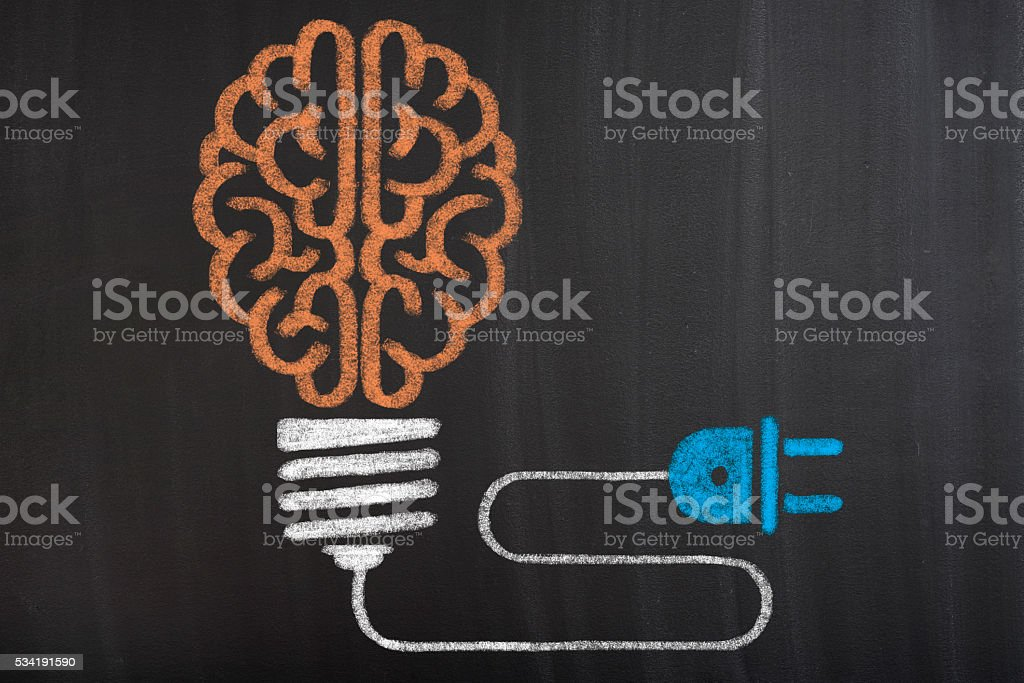 Human brain in light bulb stock photo