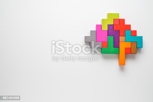 istock Human brain is made of multi-colored wooden blocks. 882484098