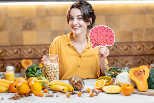 Human brain model and variety of healthy fresh food stock photo