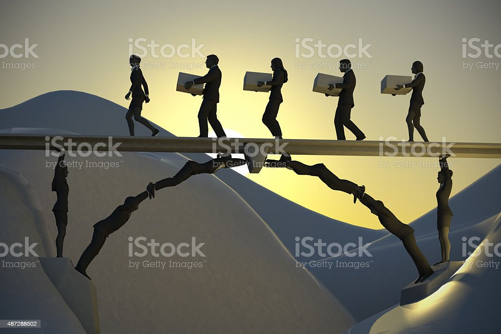 Human Bridge working until dawn A bridge made of people in teamwork, where a leader and the team of executives carry items from one side of the bridge to the other until the early hours of dawn 2015 Stock Photo