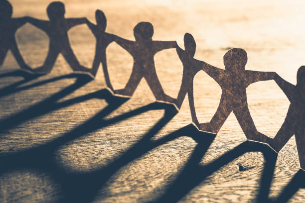 human chain paper - unity stock pictures, royalty-free photos & images
