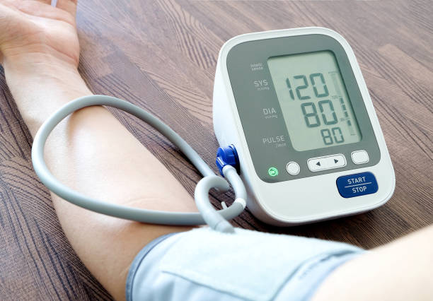 Human check blood pressure monitor and heart rate monitor with digital pressure gauge. Health care and  Medical concept stock photo