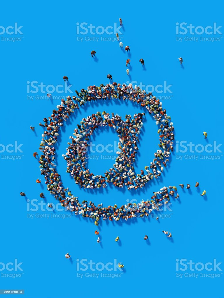 Human Crowd Forming A Big At Symbol: Social Media Concept and Crowdfunding Concept stock photo