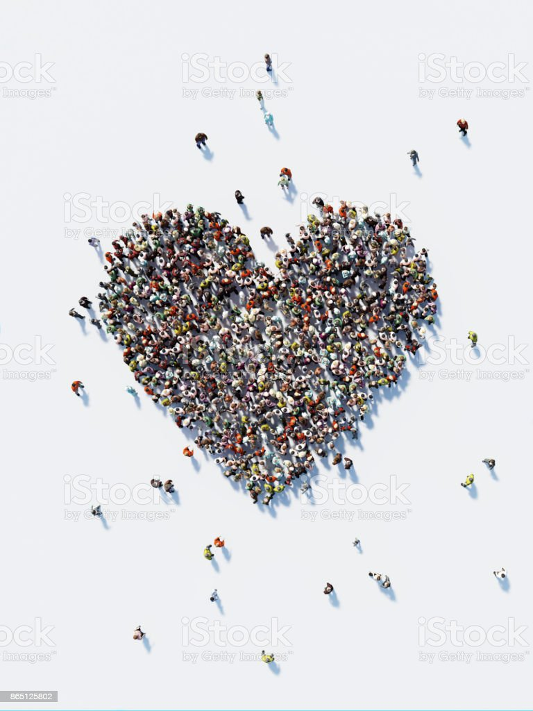 Human Crowd Forming A Big Heart Shape: Love and Donation Concept stock photo