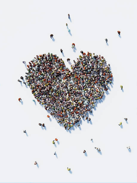 human crowd forming a big heart shape: love and donation concept - heart shape stock photos and pictures