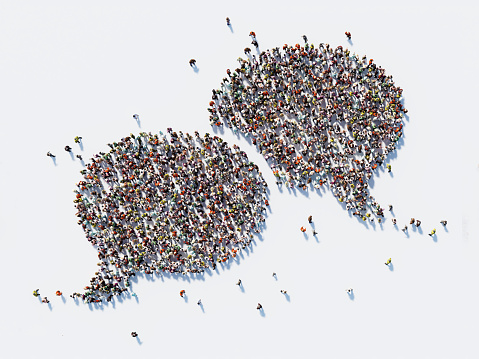 Human crowd forming a big speech bubble on white background. Horizontal composition with copy space. Clipping path is included. Communication And Social Media Concept