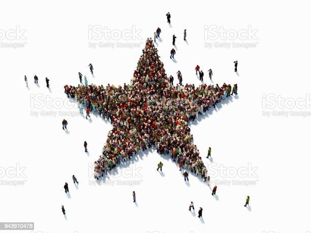 Photo of Human Crowd Forming A Big Star Shape On White Background