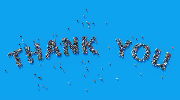 Human Crowd Forming A Big Thank You Text:  Gratitude Concept stock photo