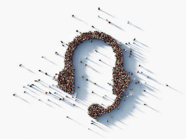 Human Crowd Forming A Headset Symbol on White Background stock photo