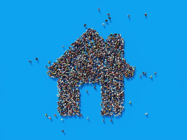 Human Crowd Forming A House Symbol: Real Estate and Crowdfunding Concept stock photo