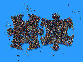 istock Human Crowd Forming A Jigsaw Puzzle Symbol: Solution And Social Media Concept 935757256