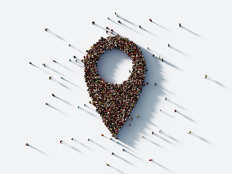 Human crowd forming a map pointer symbol on white background. Horizontal composition with clipping path and copy space.