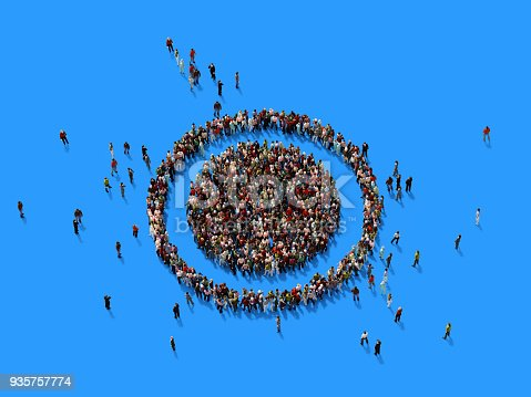 istock Human Crowd Forming A Target Symbol: Target Market Concept 935757774
