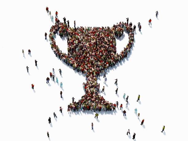 human crowd forming a trophy shape - success concept - trophy award stock photos and pictures