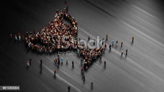 Human crowd forming a big trophy shape on black background. Horizontal  composition with selective focus and copy space. Success and reward concept.